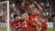 Toronto FC midfielder Alejandro Pozuelo, second left, celebrates after scoring on a penalty kick during extra time against Atlanta United during second half MLS Soccer action in Toronto, on Wednesday, June 26, 2019. THE CANADIAN PRESS/Andrew Lahodynskyj