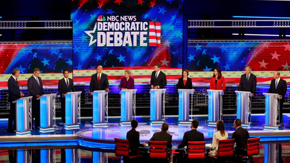 Democratic presidential candidate former Housing and Urban Development Secretary Julian Castro, third from left, answers a question, during a Democratic primary debate hosted by NBC News at the Adrienne Arsht Center for the Performing Art, Thursday, June 27, 2019, in Miami. (AP Photo/Wilfredo Lee)