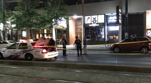 Shots were fired into the window of a pet food store near Spadina Avenue and Queen Street West. (Michael Nguyen/ CP24)