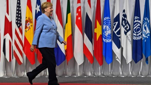 Merkel shaken not stirred after tremors spark health concerns