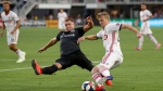 D.C. United midfielder Russell Canouse, left, defends against Toronto FC forward Jacob Shaffelburg during the first half of an MLS soccer match Saturday, June 29, 2019, in Washington. The teams tied 1-1. (AP Photo/Andrew Harnik)