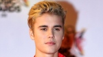 In this Nov. 7, 2015 file photo, Justin Bieber arrives at the Cannes festival palace in Cannes, southeastern France. (AP Photo/Lionel Cironneau, File)