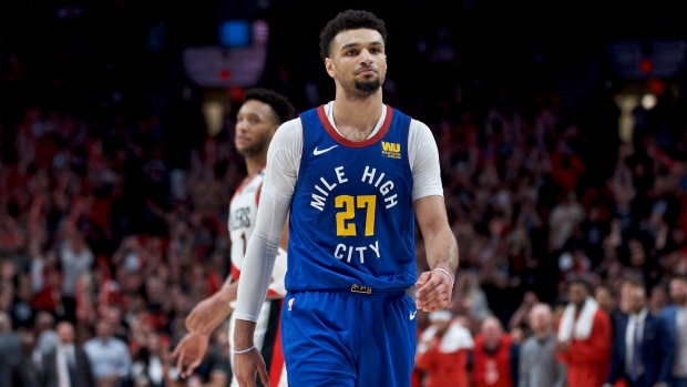 Denver Nuggets guard Jamal Murray walks off the court after the team's loss to the Portland Trail Blazers in Game 6 of an NBA basketball second-round playoff series Thursday, May 9, 2019, in Portland, Ore. (AP Photo/Craig Mitchelldyer)