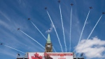 Royal Canadian Air Force Snowbirds fly past the Peace Tower during the Canada Day noon show on Parliament Hill in Ottawa on Monday, July 1, 2019. THE CANADIAN PRESS/Justin Tang