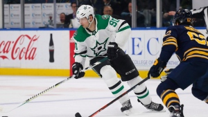 Buffalo Sabres defenseman Brandon Montour (62) defends against Dallas Stars forward Jason Spezza (90) during the first period of an NHL hockey game Tuesday, March 12, 2019, in Buffalo, N.Y. (AP Photo/Jeffrey T. Barnes)