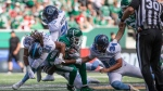 Toronto Argonauts wide receiver Alex Charette (11), defensive back Matt Webster (20) and kicker Drew Brown collide with Saskatchewan Roughriders wide receiver Christion Jones during first half CFL football action in Regina on Monday, July 1, 2019. THE CANADIAN PRESS/Kayle Neis