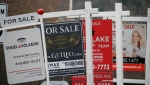 Real estate for sale signs are shown in Oakville, Ont. on Dec.1, 2018. THE CANADIAN PRESS/Richard Buchan