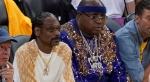 Rappers Snoop Dogg, left, and E-40 watch during the first half of Game 4 of basketball's NBA Finals between the Golden State Warriors and the Toronto Raptors in Oakland, Calif., Friday, June 7, 2019. (AP Photo/Tony Avelar)