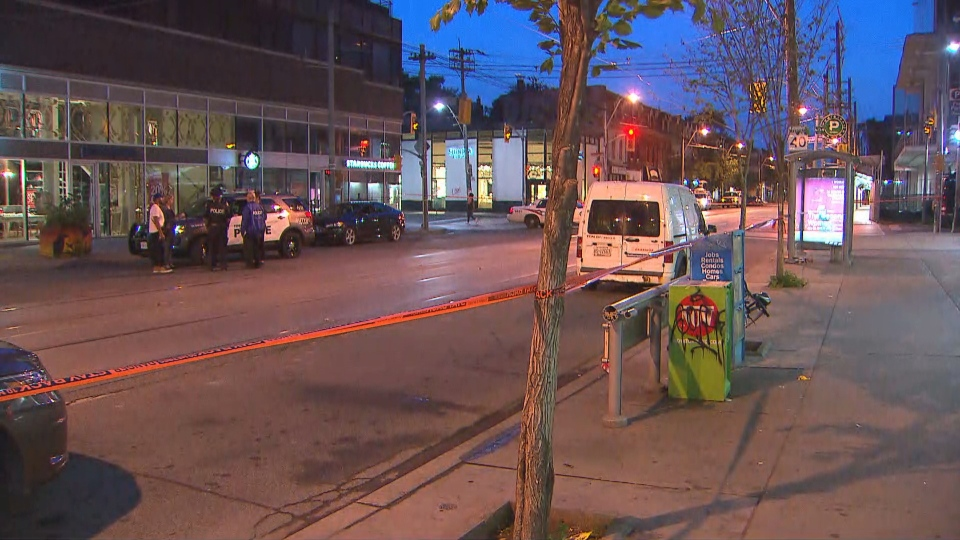 Police tape is shown at the scene of a triple shooting near Queen Street West and Ossington Avenue on July 8.