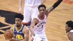 Golden State Warriors guard Quinn Cook (4) moves past Toronto Raptors guard Patrick McCaw (1)during first half basketball action in Game 1 of the NBA Finals in Toronto on Thursday, May 30, 2019. THE CANADIAN PRESS/Frank Gunn
