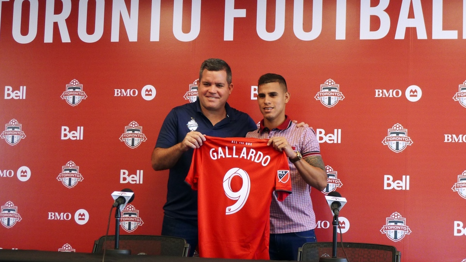 The new Toronto FC winger Erickson Gallardo, a 22-year-old winger from Venezuela poses with his agent Sebastian Cano, in Toronto, on Tuesday, July 9, 2019. THE CANADIAN PRESS/Neil Davidson
