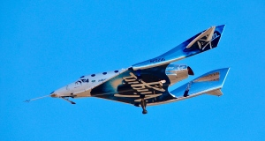 In this Dec. 13, 2018 file photo, a view of Virgin Galactic prior to it reaching space for the first time during its 4th powered flight from Mojave, Calif.  (AP Photo/Matt Hartman, File)