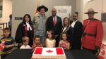 Immigration, Refugees and Citizenship minister Ahmed Hussen, centre, poses with new Canadians, including Arcade Fire frontman Win Butler, after a citizenship ceremony in Montreal in a Tuesday, July 9, 2019, handout photo posted to social media. THE CANADIAN PRESS/HO-Twitter, @HonAhmedHussen