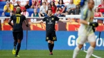 Columbus Crews' Patrick Mullins (32) celebrates scoring a goal past New York Red Bulls goalkeeper Luis Robles during the first half of an MLS soccer match on Saturday, July 28, 2018, in Harrison, N.J. (AP Photo/Adam Hunger)