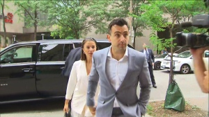 Jacob Hoggard is seen at a Toronto courthouse on July 11, 2019 with his wife. (CTV News Toronto)