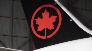 The tail of an Air Canada aircraft is seen at a hangar at the Toronto Pearson International Airport in Mississauga, Ont., on February 9, 2017. THE CANADIAN PRESS/Mark Blinch