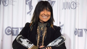 Buffy Sainte-Marie holds her awards at the JUNO Gala dinner in Calgary, Saturday, April 2, 2016. THE CANADIAN PRESS/Jonathan Hayward
