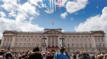 In this Saturday, June 8, 2019 file photo, Red Arrows planes fly over Buckingham Palace during the annual Trooping the Colour Ceremony in London. (AP Photo/Frank Augstein, file)
