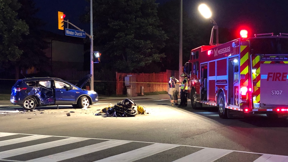 Emergency crews respond to the scene of a collision between and SUV and a motorcycle at Homelands Drive and Winston Churchill Boulevard Friday July12, 2019. (David Ritchie)