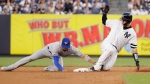 New York Yankees' Gary Sanchez, right, slides to second base for a double as Toronto Blue Jays' Cavan Biggio attempts to tag him out during the fourth inning of a baseball game Friday, July 12, 2019, in New York. (AP Photo/Frank Franklin II)