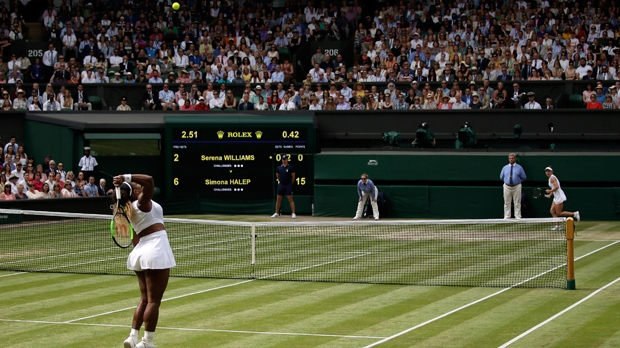 United States' Serena Williams, left, serves to Romania's Simona Halep, right, during the women's singles final match on day twelve of the Wimbledon Tennis Championships in London, Saturday, July 13, 2019. (AP Photo/Tim Ireland)