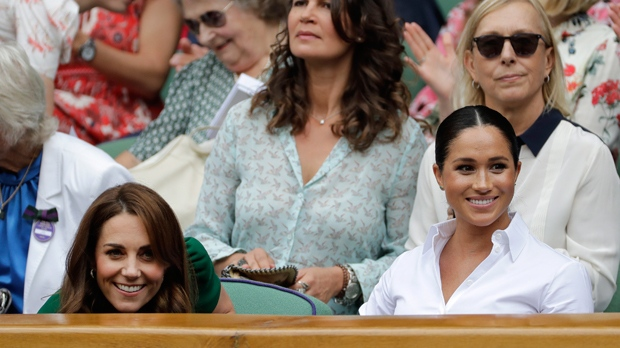 Kate, Duchess of Cambridge, left, and Meghan, Duchess of Sussex sit in the Royal Box on Centre Court to watch the women's singles final match between Serena Williams of the United States and Romania's Simona Halep on day twelve of the Wimbledon Tennis Championships in London, Saturday, July 13, 2019. (AP Photo/Ben Curtis)