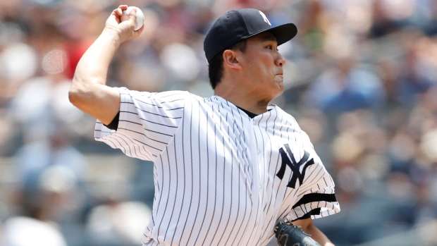quality design c6797 e83ba New York Yankees starting pitcher Masahiro Tanaka winds up during the first  inning of a baseball game against the Toronto Blue Jays, Sunday, July 14,  2019, ...