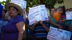In this Dec. 17, 2018 photo, Salvadoran women rally in support of Imelda Cortez, a 20-year-old rape survivor who was accused of attempting to abort her abuser's baby, outside her trial in Usulutan, El Salvador. Another young woman, Evelyn Beatriz Hernandez, faces a second trial for murder on Monday, July 14, 2019 in a case that has drawn international attention because of the country's highly restrictive abortion laws. (AP Photo/Salvador Melendez)