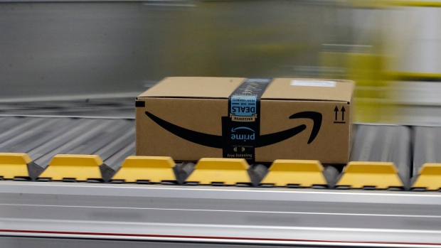 In this Feb. 9, 2018, file photo a box for an Amazon prime customer moves through the new Amazon Fulfillment Center in Sacramento, Calif. (AP Photo/Rich Pedroncelli, File)