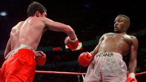 In this April 12, 1997, file photo, Pernell Whitaker, right, leans away from a punch by Oscar De La Hoya during their WBC Welterweight Championship fight at Thomas & Mack Center in Las Vegas. De La Hoya won by unanimous decision. Former boxing champion Pernell Whitaker has died after he was hit by a car in Virginia. He was 55. Police in Virginia Beach on Monday say Whitaker was a pedestrian when struck by the car Sunday night, July 14, 2019. The driver remained on the scene, where Whitaker was pronounced dead. (AP Photo/Eric Draper, File)
