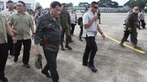 """In this July 15, 2019, photo released by the Malacanang Presidential Photo, Philippine President Rodrigo Duterte, second from left, arrives at the Jolo airport, Sulu province, southern Philippines. Duterte is """"seriously considering"""" cutting diplomatic ties with Iceland, which spearheaded a resolution that asked the U.N.'s top human rights body to look into the thousands of deaths of suspects under his anti-drug crackdown. (Ace Morandante/Malacanang Presidential Photo via AP)"""