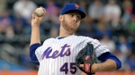 New York Mets starting pitcher Zack Wheeler delivers the ball during the first inning of a baseball game Saturday, May 20, 2017 at Citi Field in New York. (AP Photo/Bill Kostroun)