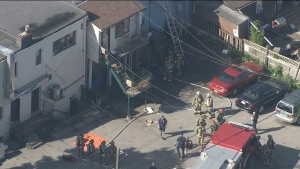 Firefighters are shown at the scene of a two-alarm blaze on Warden Avenue north of Danforth Avenue on Tuesday morning.