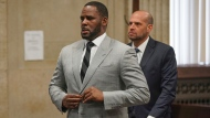 In this June 6, 2019, file photo, singer R. Kelly pleaded not guilty to 11 additional sex-related felonies during a court hearing before Judge Lawrence Flood at Leighton Criminal Court Building in Chicago.  (E. Jason Wambsgans/Chicago Tribune via AP, Pool)