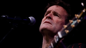 In this Saturday, Nov. 11, 2017 file photo, musician Johnny Clegg performs on stage during his own farewell concert in Johannesburg. Clegg died at his home in Johannesburg Tuesday, July 16, 2019 after suffering from pancreatic cancer. (AP Photo/Denis Farrell, File)