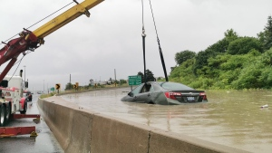 Flooding affecting Highway 401 in Toronto on Wednesday July 17, 2019 is seen. (Twitter / @SonnySubra)