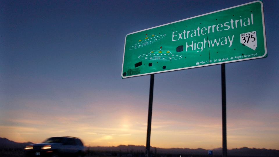 In this April 10, 2002, file photo, a vehicle moves along the Extraterrestrial Highway near Rachel, Nev., the closest town to Area 51. (AP Photo/Laura Rauch, File)
