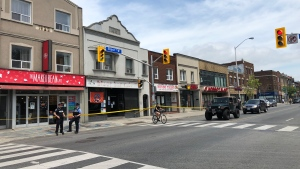 Police tape is shown at the scene of a homicide investigation on Bloor Street near Dovercourt Road on Thursday.