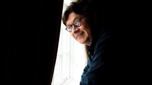 Musician and songwriter Robbie Robertson poses in Toronto on Monday, Oct. 7, 2013. THE CANADIAN PRESS/Nathan Denette