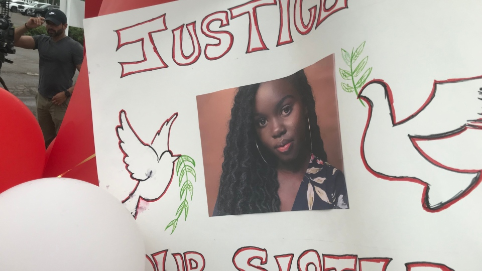 A poster put at the site where Jackline Keji Gore died is shown. (Brandon Rowe/CTV News Toronto)