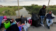 "In this Nov. 2, 2018, file photo, Yenly Morales,left, and Yenly Herrera, right, immigrants from Cuba seeking asylum in the United States, wait on the Brownsville and Matamoros International Bridge in Matamoros, Mexico. The U.S. government will expand its policy requiring asylum seekers to wait outside the country in one of Mexico's most dangerous cities. According to officials for two congressional Democrats, the Department of Homeland Security says it will implement its ""Migrant Protection Protocols"" in Brownsville, Texas, across the border from Matamoros, Mexico. Matamoros is in Mexico's Tamaulipas state, which the U.S. government warns citizens not to visit due to violence and kidnappings.(AP Photo/Eric Gay, File)"