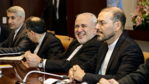 Iranian Foreign Minister Mohammad Javad Zarif smiles as he meets with U.N. Secretary General Antonio Guterres at United Nations headquarters Thursday, July 18, 2019. (AP Photo/Frank Franklin II)