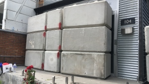 Concrete blocks ate shown outside the entrance to an unlicensed cannabis dispensary on Harbord Street on Friday afternoon. (Leena Latafat)