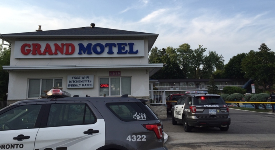 The two men were found face down in the pool at the Grand Motel in Scarborough.