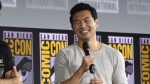"Simu Liu speaks during the ""Shang-Chi and The Legend of the Ten Rings"" portion of the Marvel Studios panel on day three of Comic-Con International on Saturday, July 20, 2019, in San Diego. (Photo by Chris Pizzello/Invision/AP)"