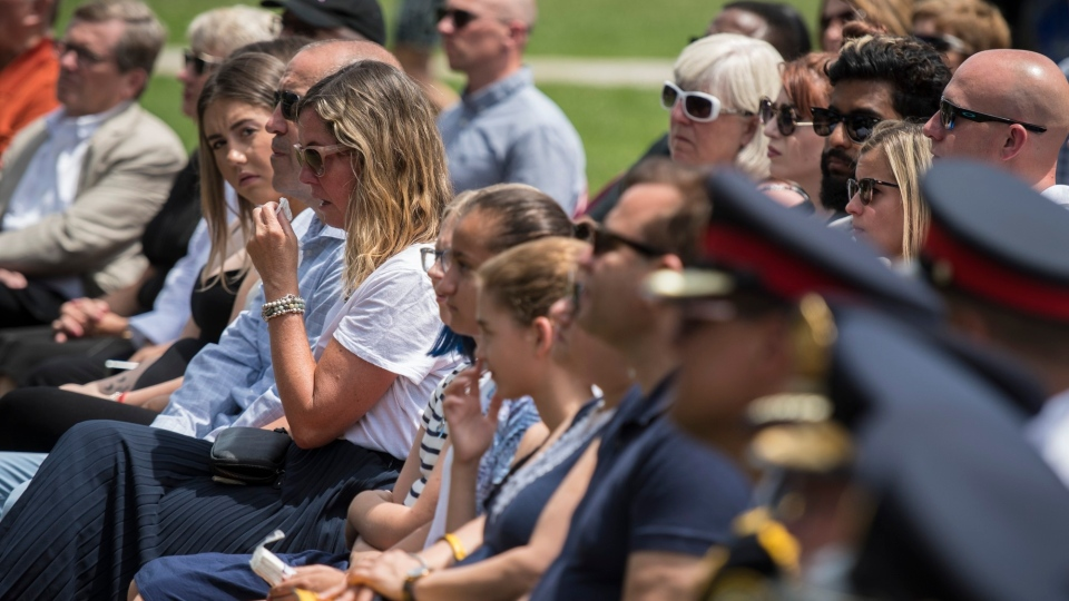 Survivors and family members who lost their loved ones in the Danforth shooting attack, are photographed during an emotional commemoration of the Danforth shooting at Withrow Park in Toronto on Sunday, July 21, 2019. THE CANADIAN PRESS/ Tijana Martin