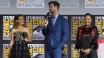 "Natalie Portman, from left, Chris Hemsworth and Tessa Thompson participate during the ""Thor Love And Thunder"" portion of the Marvel Studios panel on day three of Comic-Con International on Saturday, July 20, 2019, in San Diego. (Photo by Chris Pizzello/Invision/AP)"