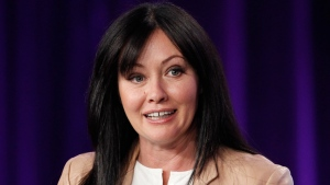"FILE - In this Jan. 14, 2012, file photo, Shannen Doherty participates in a panel for the television show ""Shannen Says"" on WE tv during the AMC Networks portion of the Television Critics Association Winter Press Tour in Pasadena, Calif. Doherty will guest star in the season four premiere of ""Riverdale,"" which is set to honor Luke Perry. The show's executive producer, Roberto Aguirre-Sacasa, made the announcement Sunday at Comic-Con in San Diego. (AP Photo/Danny Moloshok, File)"