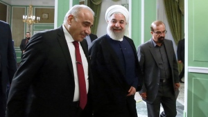 In this photo released by official website of the Office of the Iranian Presidency, Iraqi Prime Minister Adel Abdel Mahdi, left, and Iranian President Hassan Rouhani, meet at the Saadabad Palace in Tehran, Iran, Monday, July 22, 2019. (Iranian Presidency Office via AP)