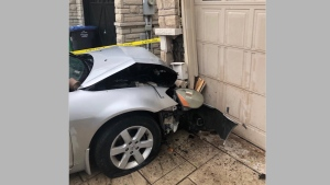 A man sustained non-life-threatening injuries after a vehicle crashed into a home in Brampton. (Twitter/Peel Regional police)